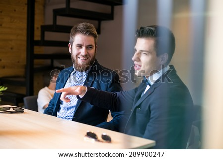 Hipster friends talking in a cafe - stock photo