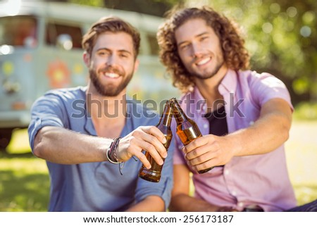 Hipster friends toasting with beers on a summers day - stock photo