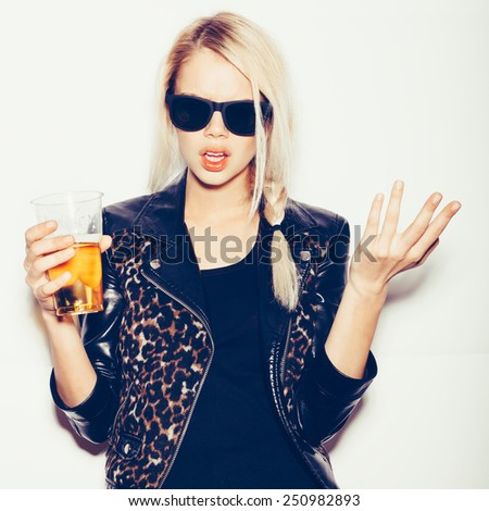 Hipster girl in sunglasses and black leather jacket  drinking beer, not isolated on white background - stock photo