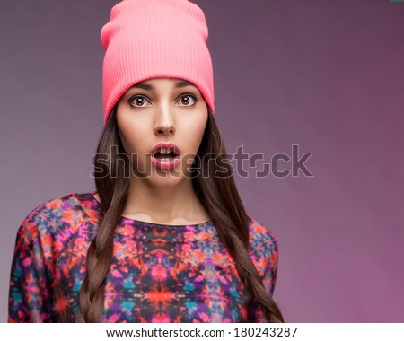 Hipster girl showing wow face  - stock photo