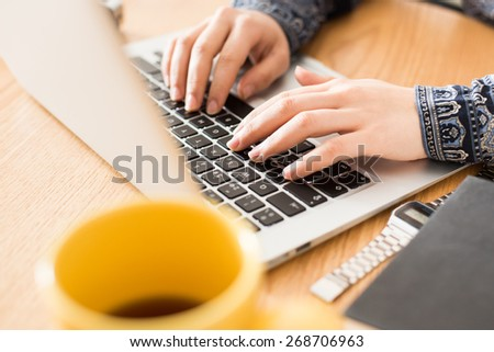 Hipster girl using her laptop at home. - stock photo
