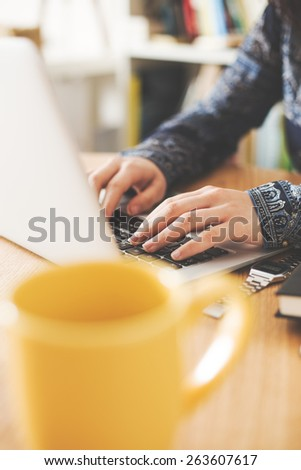 Hipster girl using her laptop at home, vintage. - stock photo