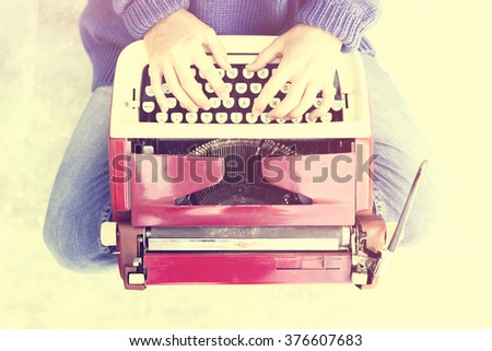 Hipster girl with old style typewriter  - stock photo