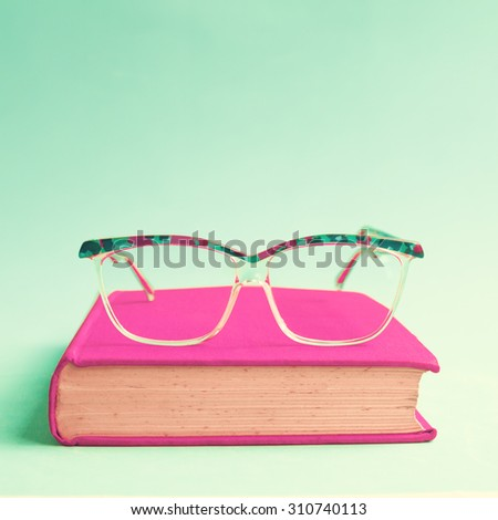 Hipster glasses and book  - stock photo