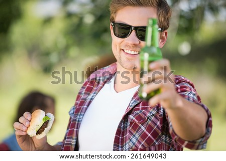 Hipster have lunch and beers on a sunny day - stock photo