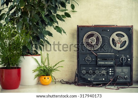 hipster - hippie room with a dusty magnetophone and plants - stock photo