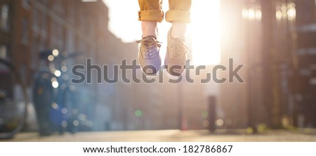 Hipster man feet jumping concept series - stock photo