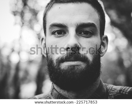 Hipster man portrait  in black and white in horizontal composition. - stock photo