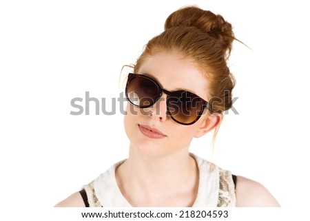 Hipster redhead wearing large sunglasses on white background - stock photo