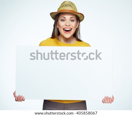 Hipster style girl holding big white sign board. Advertising banner. Yellow hat. - stock photo