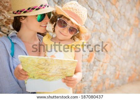 Hipster woman and girl in summer city. Travel and vacations concept - stock photo
