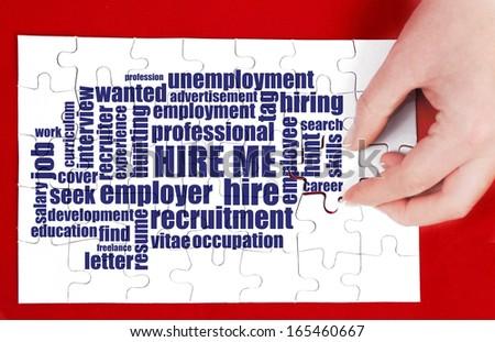 hire me wordclou puzzle - stock photo