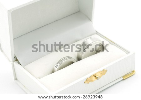 His/ hers wedding rings in a white jewelery box - stock photo