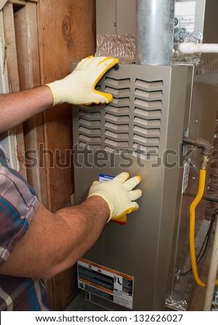 Hispanic airconditioning repair man performing maintenance - stock photo