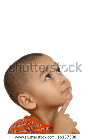 Hispanic boy looking up - stock photo