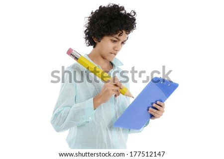 hispanic business woman taking notes with huge yellow pencil on white background - stock photo