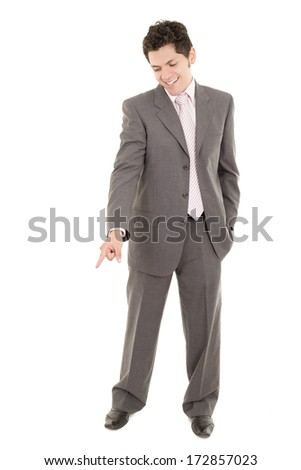 Hispanic businessman looks down at the ground - stock photo