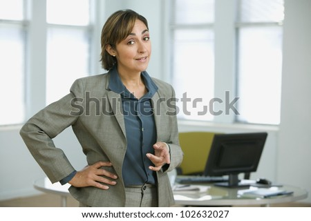 Hispanic businesswoman pointing - stock photo