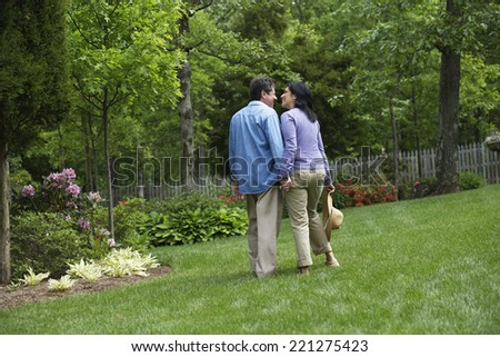 Hispanic couple holding hands - stock photo
