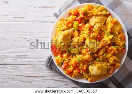 Hispanic cuisine: Arroz con pollo close up in a bowl on the table. horizontal top view - stock photo
