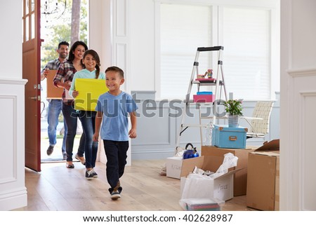 Hispanic Family Moving Into New Home - stock photo