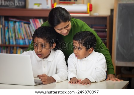 Hispanic Family with Laptop in Home-school Setting - stock photo