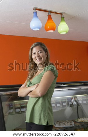 Hispanic female business owner in gourmet food store - stock photo