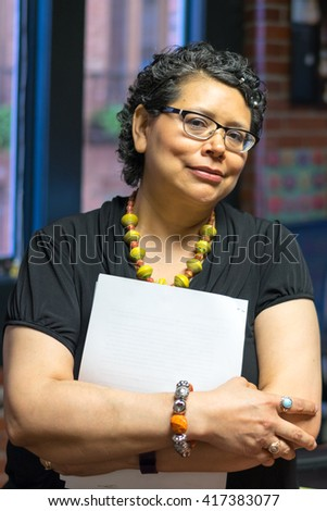 Hispanic Female Waits Patiently During Chemo Treatment - stock photo