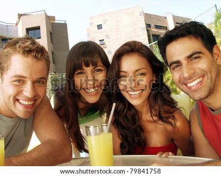 Hispanic friends enjoying together. - stock photo