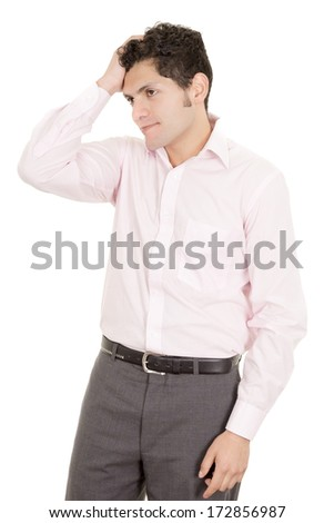 hispanic stressed businessman in suit - stock photo