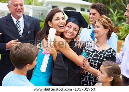 Hispanic Student And Family Celebrating Graduation - stock photo