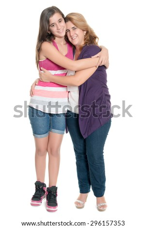 Hispanic teenage girl hugging her mother isolated on a white background - stock photo