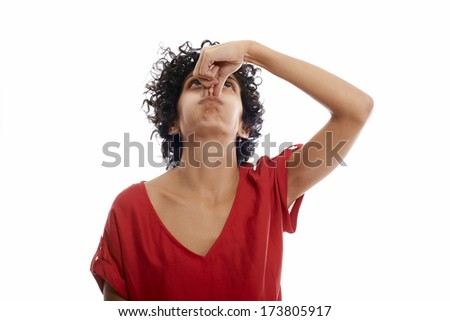 hispanic woman holding breath closing nose with fingers on white background - stock photo