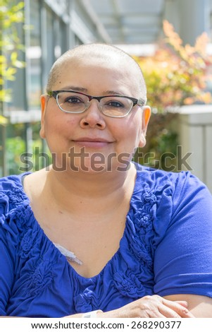 Hispanic woman with breast cancer learns to deal with hair loss - stock photo