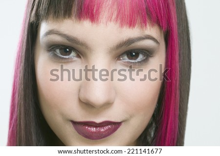 Hispanic woman with dyed hair - stock photo