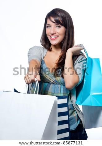 Hispanic woman with shopping bags - stock photo