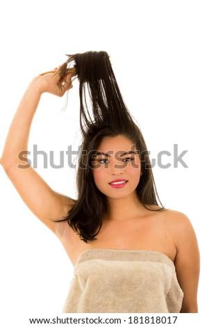 hispanic woman with wild brunette hair on white background - stock photo