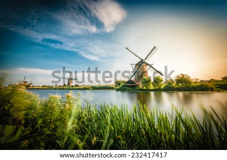 Historians Dutch windmills near Rotterdam - stock photo