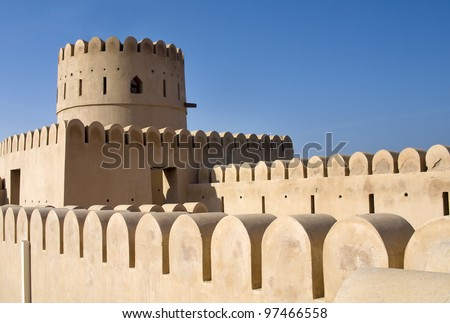 Historic adobe fortification, watchtower of Sunaysilah Castle or Fort in Sur. Sultanate of Oman, Middle East - stock photo