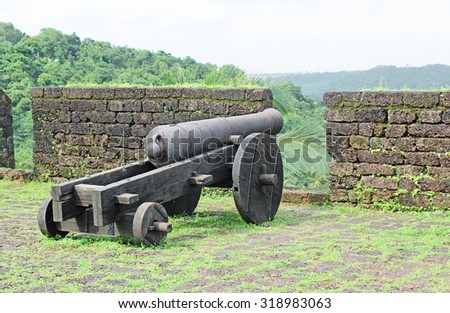 Historic antique canon used by the Portuguese during their occupation of Goa, India, used to protect from intruders and attackers - stock photo