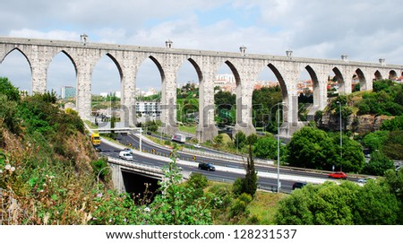 historic aqueduct in the city of Lisbon built in 18th century, Portugal (panoramic picture) - stock photo