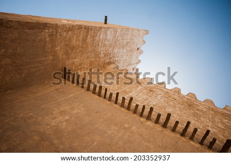 Historic Barazn Tower in the deserts of Qatar on the edge of the Persian gulf on a sunny summer day - stock photo