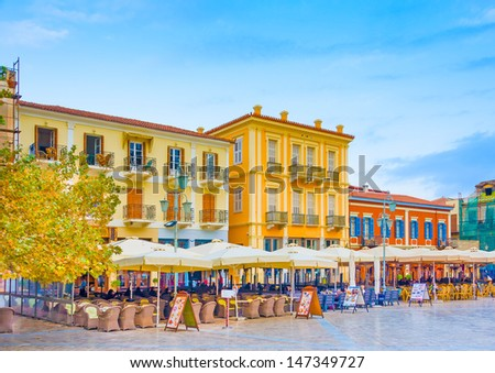 Historic beautiful buildings around the main square of Nafplio town in Greece - stock photo