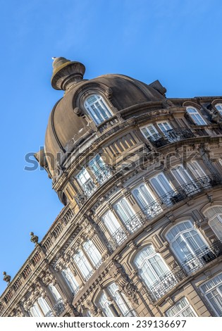 Historic building on the Liberdade square of Porto with a dome. - stock photo