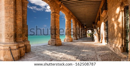 Historic building with arches and statues - stock photo