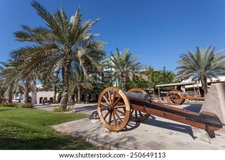 Historic cannon at the msuem of Ajman, United Arab Emirates - stock photo