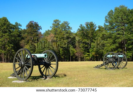 historic cannons on a battlefield - stock photo
