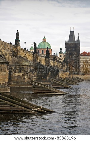 Historic center of the city of Prague, Czech republic, Europe. Medieval Charles bridge spans over the Vltava river. - stock photo