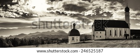 historic chapel and church at the european alps - irschenberg - germany - wilparting - stock photo