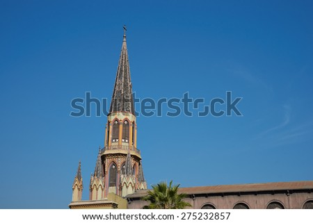 Historic church, Iglesia Corpus Dominco. Building with very tall colourfully decorated steeple in Barrio Brasil, Santiago, Chile - stock photo